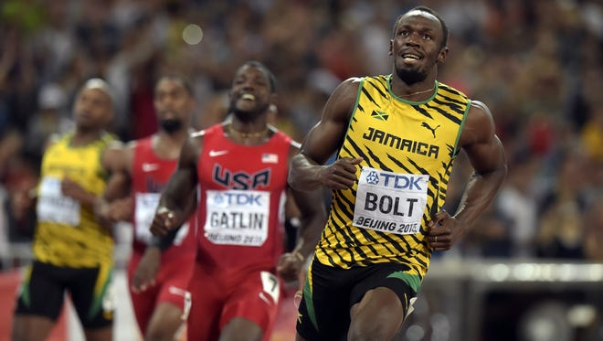 Usain Bolt beats Justin Gatlin by .01 second to win gold in the 100-meters.