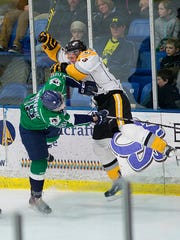 Plymouth Whalers forward Danny Vanderwiel (left) tries to avoid a collision with a Sarnia player.