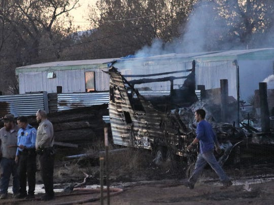 Tularosa and Otero County officials continue their investigation of a camper and mobile home fire Thursday evening.