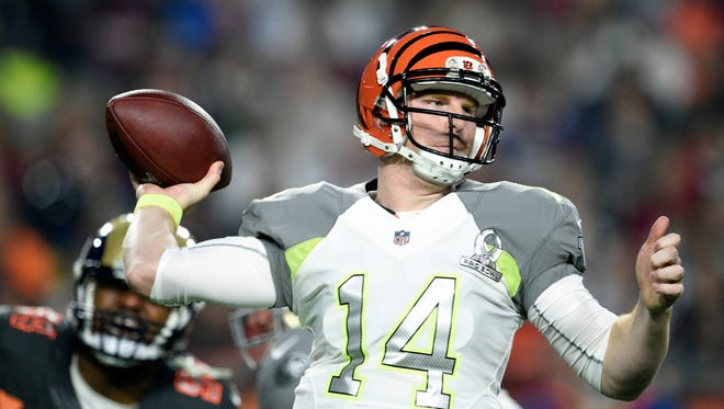 Bengals quarterback Andy Dalton gets ready to throw a pass during the Pro Bowl. Dalton's contract ranks 13th of all NFL quarterback deals in average per season.