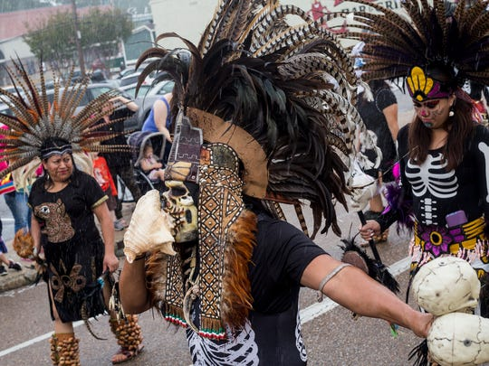 October 07, 2017 - Quetzalcoatl Aztec Dance members make their way down Madison during the Dia de los Muertos parade in Overton Square. The event markedthe beginning of festivities observing the traditional Mexican holiday to honor, remember and support deceased loved ones.