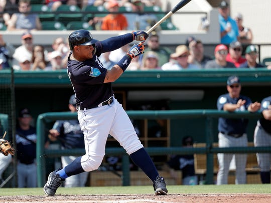 Detroit Tigers' Miguel Cabrera hits a bases-loaded double in the third inning against the Atlanta Braves on Sunday, March 11, 2018 in Lakeland, Fla.