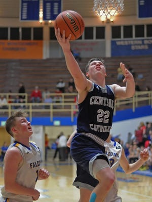 Central Catholic junior Jake Page drives in for a layup Saturday morning in game one of the Frankfort Class A regional.