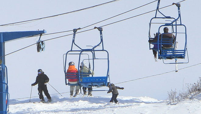 People enjoy the fresh snow as they ski and board at Thunder Ridge ski area in Patterson (file photo)