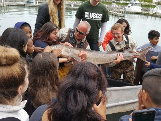 Students from Maltby Middle School meet a Detroit River