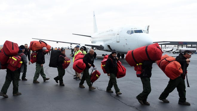 Teams of wild land firefighters were flown into  the area on Tuesday, November 15, 2016 to combat wildfires throughout the Georgia, North Carolina, and Tennessee.