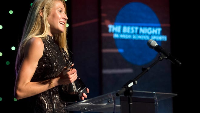 Rebecca Story accepts the Athlete of the Year award at the News Sentinel Sports Awards at the Tennessee Theatre on Wednesday, June 7, 2017.