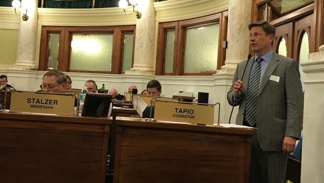 Sen. Neal Tapio, R-Watertown, addresses the Senate about his resolution Tuesday.