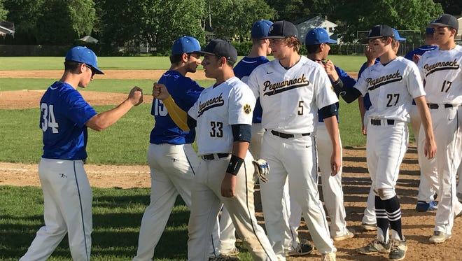 Seniors Dante Cancro (33) and Ben Hampson (5) lead the Pequannock handshake line after their team beat Hawthorne in the North 1, Group 2 baseball quarterfinals on Friday, May 26, 2017.