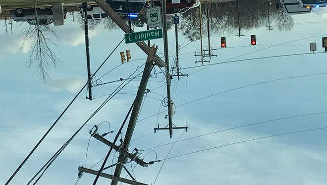A snapped telephone poll near the scene of a wreck in the Mauldin area on Tuesday, Feb. 15, 2018.