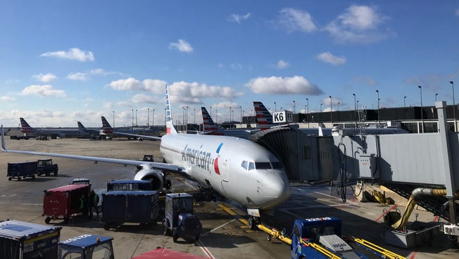 An American Airlines plane sits at a gate at Chicago O'Hare airport on March 7, 2018.