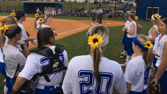 McNairy Central's softball team gathers in a circle before the Lady Bobcats' 2-1 win over Ripley in a Class AA sectional on May 18, 2018.