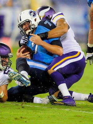 Titans quarterback Zach Mettenberger is sacked by Vikings defensive end Justin Trattou during the second quarter