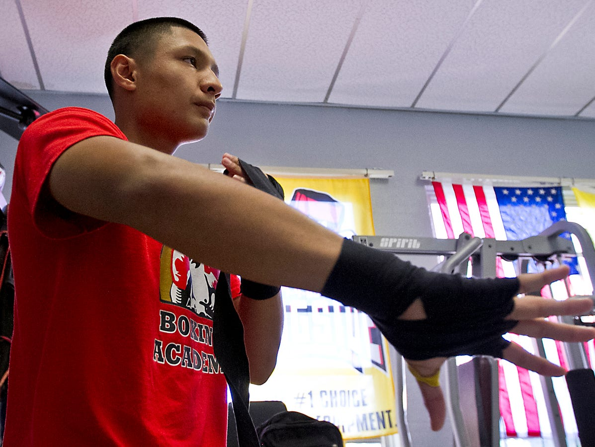 Benjamin Orozco, a Riverdale High School senior, prepares to work out at the Fort Myers PAL Boxing Academy Tuesday afternoon (10/20/15). Orozco will be boxing in a major qualifier next week for the chance to attend the Olympic Trials. He has been boxing since he was 8 years old.