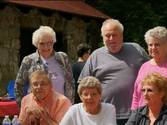 Jeanne Randall (bottom, center) with her family. From