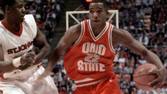 Ohio State's Michael Redd (22) drives against St. John's Tyrone Grant Saturday, March 20, 1999, in the NCAA South Regional Championship in Knoxville, Tenn. Ohio State won 77-74 to advance to the Final Four.