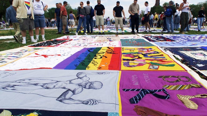 Visitors look at the AIDS Quilt on the Washington Mall in 2000.