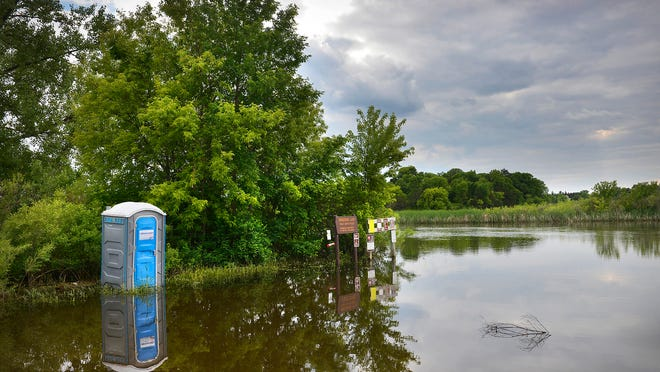 The parking lot and most of the Horseshoe Lake public water access on Minnesota Highway 22 lies underwater Tuesday  in Richmond. The Stearns County Sheriff's Office has begun placing wake-reduction signs in the area.