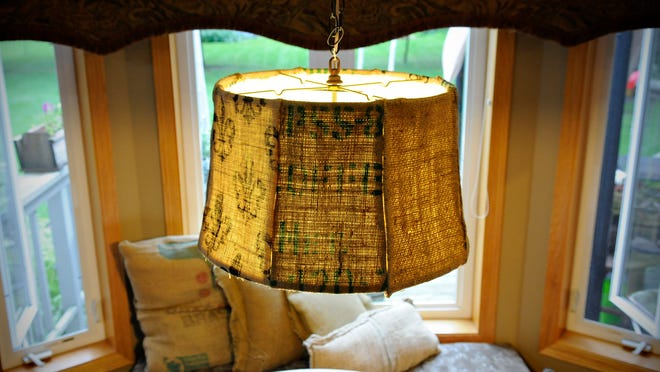 A repurposed lamp shade covered in new material and a light kit creates a new light fixture for the home Wednesday, Sept. 3.