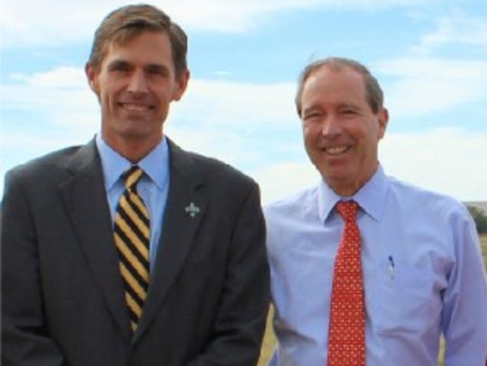 Sen. Martin Heinrich, left, stands next to Sen. Tom