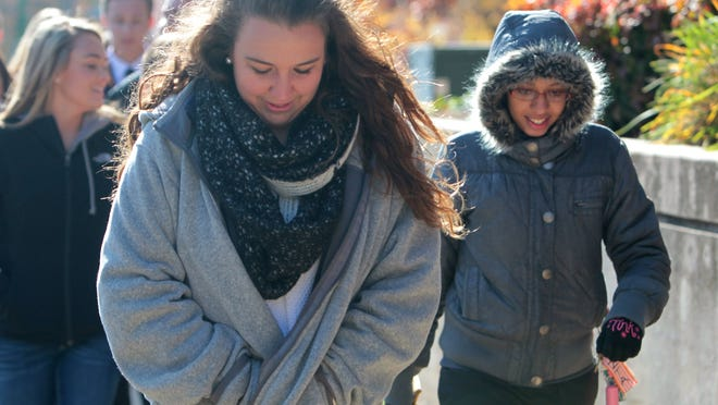 "Emma Wheat, left, and Yousra Alaoui-Sosse lead a tour in 31-degree weather at Drury University on Thursday. ""I'm too international for this,"" said Alaoui-Sosse, who is from Qatar. Last year she called her dad, crying, and said, ""The wind is trying to kill me."""