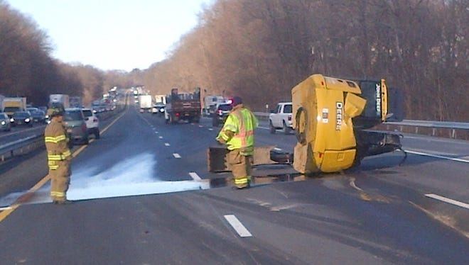 An excavator was knocked onto the Thruway in Chestnut Ridge after a tractor-trailer struck the Hungry Hollow Road overpass on Wednesday, Jan. 13, 2016.