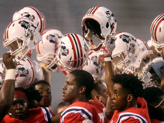 Oakland players prepare to take the field against Northside