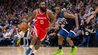 Houston Rockets guard James Harden (13) dribbles in the second quarter against Minnesota Timberwolves guard Andrew Wiggins (22) in game four of the first round of the 2018 NBA Playoffs at Target Center.