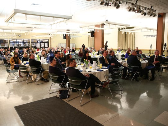 Attendees listen during the Dutchess Community College state of the college breakfast on Thursday, January 25, 2018.