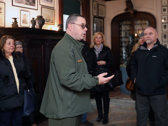 National Park Service Ranger Mike Twardy speaks to visitors inside the Home of Franklin D. Roosevelt National Historic Site in Hyde Park, Jan. 11, 2018.