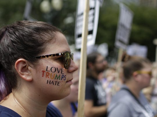 Demonstrators protest against hate, white supremacy groups and US President Donald Trump on Sunday in Chicago. Protesters were responding to violent clashes in Charlottesville, Virginia after 3 people were killed and several injured.