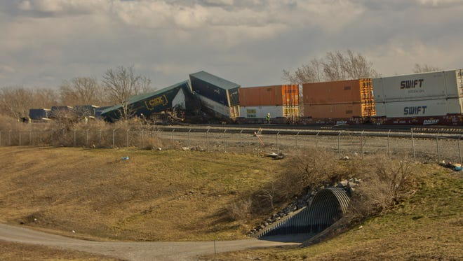 A CSX freight train derailed in high winds Wednesday near Batavia just after 1 p.m., adding to the day's strange incidents. No injuries or hazardous spills were reported.