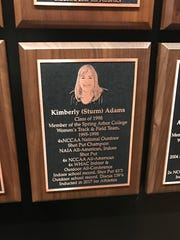 Kim Adams' plaque now hangs on the wall at the Spring Arbor Fieldhouse.