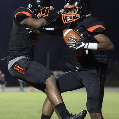 Cocoa's Caziah Holmes and Jaheim Mayes celebrate a