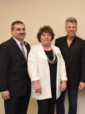 Partners in Toms River's B.E.A.T. Center include Carlos Rodriguez (l), executive director of the Foodbank of Monmouth and Ocean Counties, Patricia Donaghue, Peoples Pantry Executive Director, and Jon Bon Jovi, chairman of the Jon Bon Jovi Soul Foundation.