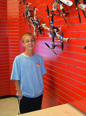 Spencer Surles of Centerville poses with the drone he created and built at Space Camp at Huntsville, Alabama.