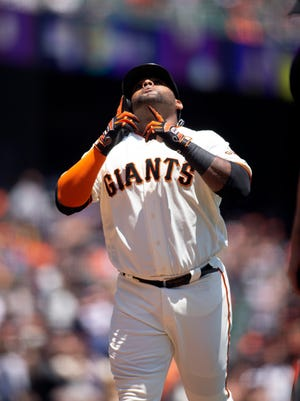 """""""Through the ups and downs in your career, you have to remain dedicated and love what you do,"""" says Giants infielder Pablo Sandoval, who will pass the 10-year service mark next month."""