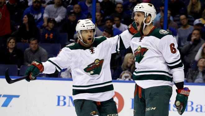 In this April 24, 2015, file photo, Minnesota Wild's Jason Pominville, left, congratulates teammate Marco Scandella after he scored during the first period in Game 5 of an NHL hockey first-round playoff series against the St. Louis Blues, in St. Louis. Former Sabres captain Jason Pominville is returning to Buffalo after being acquired along with defenseman Marco Scandella in a four-player trade with the Minnesota Wild, Friday, June 30, 2017.