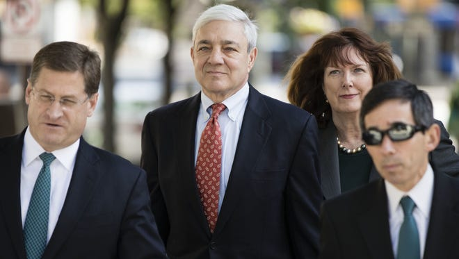 Former Penn State President Graham Spanier, center, arrives for his sentencing hearing at the Dauphin County Courthouse in Harrisburg.