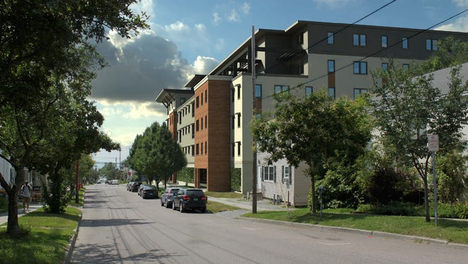 The new design for the proposed Eagles Landing apartments, viewed in this rendering from Maple Street.