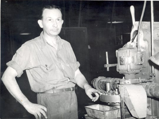 An unidentified worker at the Remington Rand plant