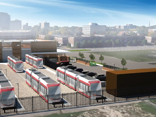 Streetcars will be stored behind the Tech Center. Decorative metal fencing, exterior lighting and landscaping are part of the design.