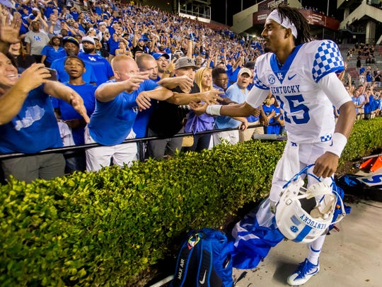 Sep 16, 2017; Columbia, SC, USA; Kentucky Wildcats quarterback Stephen Johnson (15) celebrates with fans following the Kentucky Wildcats fourth win in a row over the South Carolina Gamecocks at Williams-Brice Stadium.
