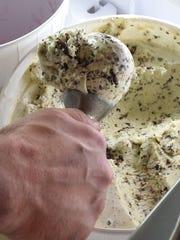 Daman Auvenshine scoops some ice cream from Browndog