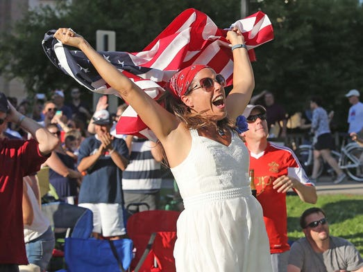 Heather Monger, Carmel celebrates the USA's second goal of the game. The city of Carmel put up a big screen and televised the USA vs. Portugal World Cup Soccer game outside at the Monon Trail and Main Street intersection Sunday June 22, 2014.