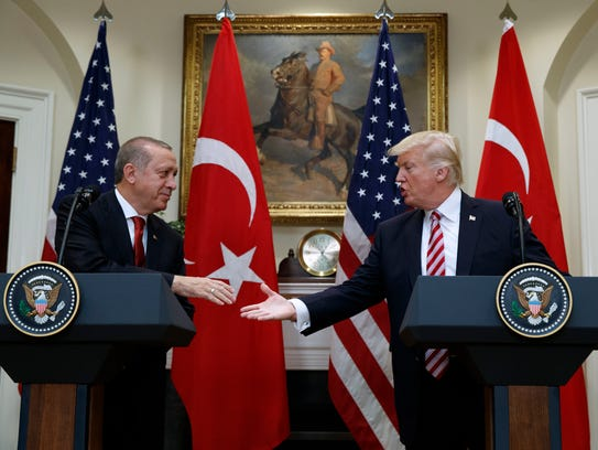 President Donald Trump shakes hands with Turkish President Recep Tayyip Erdogan in the Roosevelt Room of the White House in this file photo. Trump pressed Erdogan for the release of Andrew Brunson, a missionary with ties to Black Mountain, during their meeting.