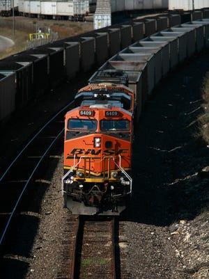 A Burlington Northern Santa Fe Railroad locomotive sits on the tracks November 3, 2009 in Fort Worth, Texas.