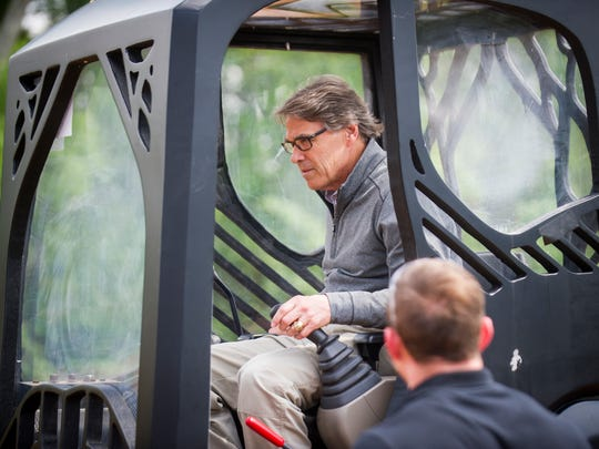 Secretary of Department of Energy Rick Perry tests out a 3D-printed excavator during a tour of Oak Ridge National Laboratory's Manufacturing Demonstration Facility on Monday, May 22, 2017.