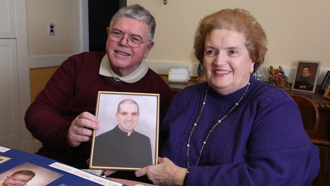 Margaret and Eugene Hamilton at their Haverstraw home with a photo of their son, Rev. Gene Hamilton, who died 20 years ago, three hours after being ordained a priest Jan. 13, 2017.