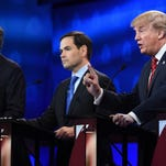 Robyn Beck, AFP/Getty ImagesBillionaire businessman Donald Trump, right, makes a point during a Republican debate, standing alongside U.S. Sen. Marco Rubio. Billionaire businessman Donald Trump, right, makes a point during a Republican debate, standing alongside two of his opponents, former Florida Gov. Jeb Bush, left, and U.S. Sen. Marco Rubio of Florida.